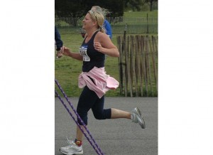 Picture of woman crossing the finish line-she did it!