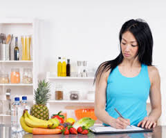 Woman filling out food journal