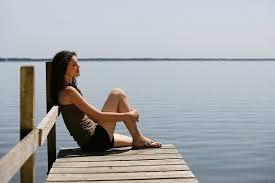 woman-sitting-on-dock